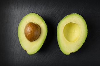 Avocado's combination of vitamins and antioxidants are saviours for unhealthy skin