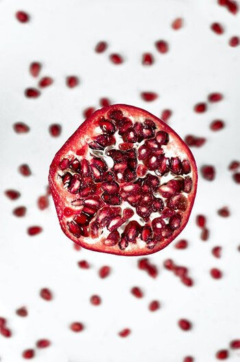 Grind pomegranate and mix with milk to make a scrub