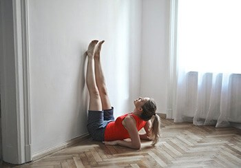 Legs up the wall yoga pose to reverse the flow of blood
