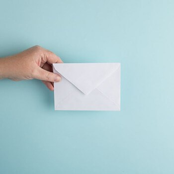 Use sponge to wet your envelope