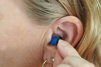 Using hearing aids or ear plugs can also cause blocked ears