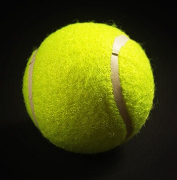 use tennis ball to massage soles of the feet