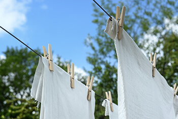 remove smell and prevent laundry from being stiff by using vinegar