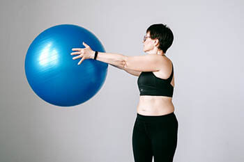 person exercising with an exercise ball
