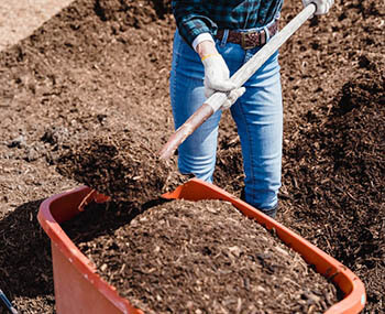 person working on compost