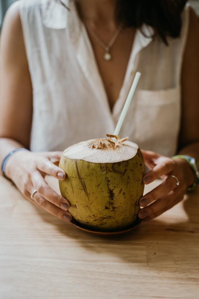 Person holding a coconut