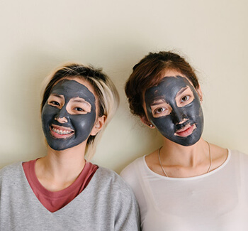 people with clay mask
