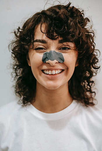 person with pore strips